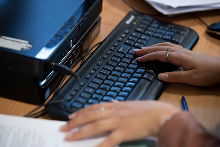close up image of someone using a computer keyboard