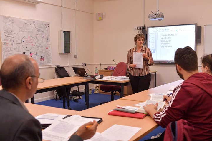 Teacher Explaining An Activity To A Class