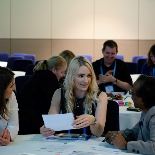 Groups Working Together At SET Conference Session