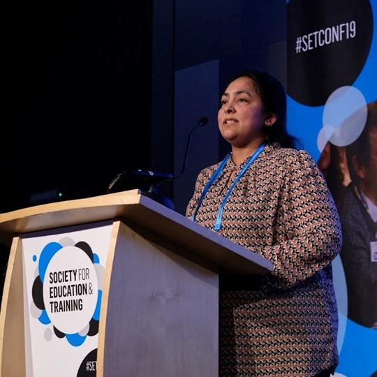 Female Speaker At Podium At SET Conference