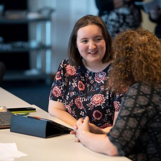 Two Female Teachers Having A Meeting