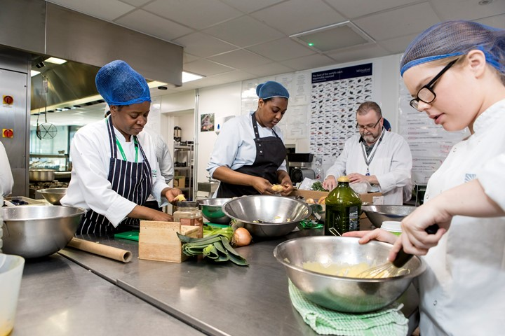 Students learning to cook in the kitchen